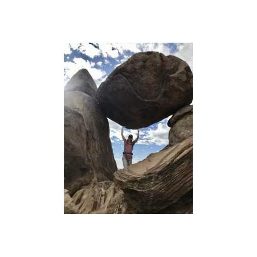Person posing with rock