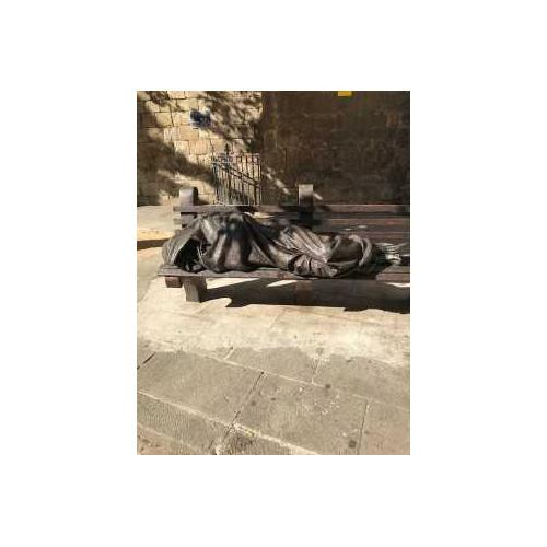 photo of statue on a bench
