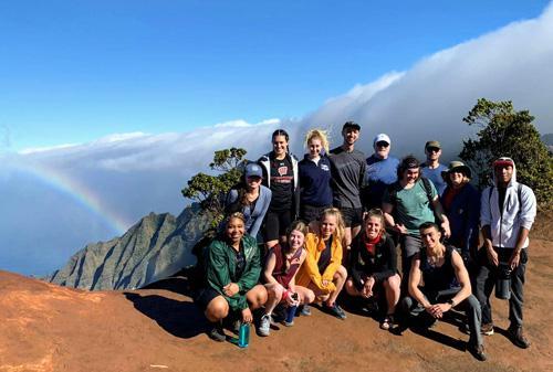 Group on mountain overlooking coastline