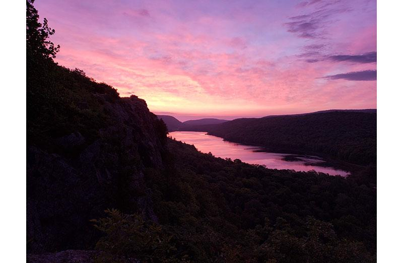Photo of river valley at sunset