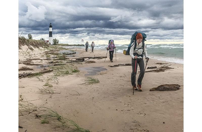 Photo of people hiking on beach