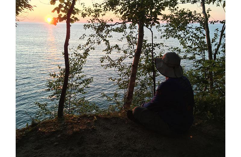 Photo of Woman sitting by lake