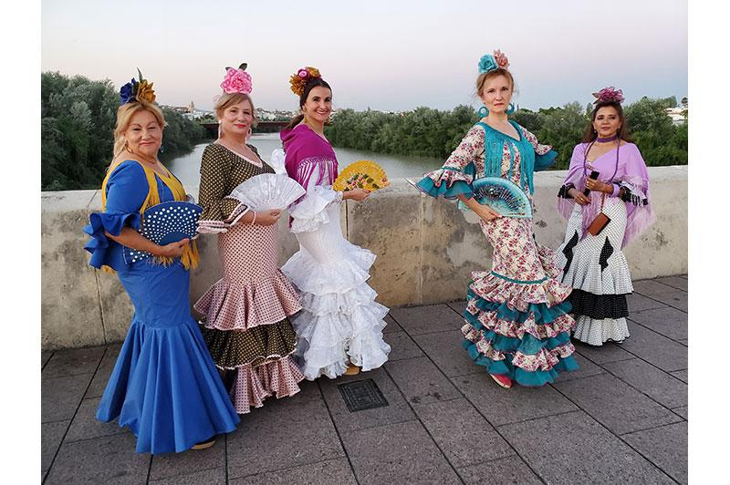 Photo of women in colorful flamenco costumes