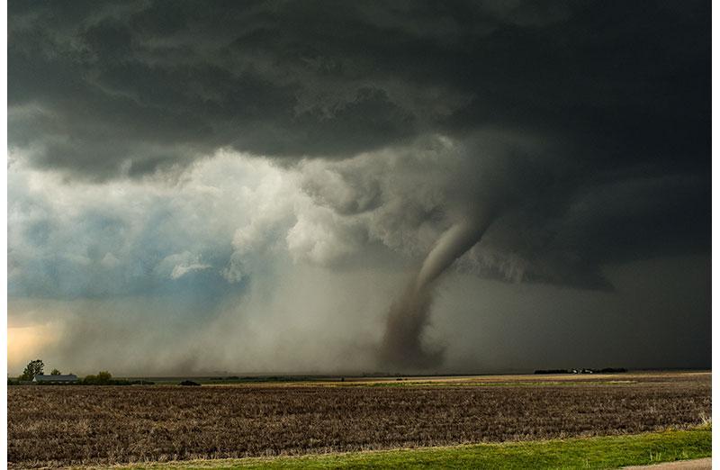 Photo of tornado going across a field