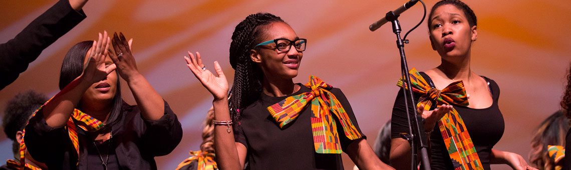 Three young women celebrate Black History Month on stage