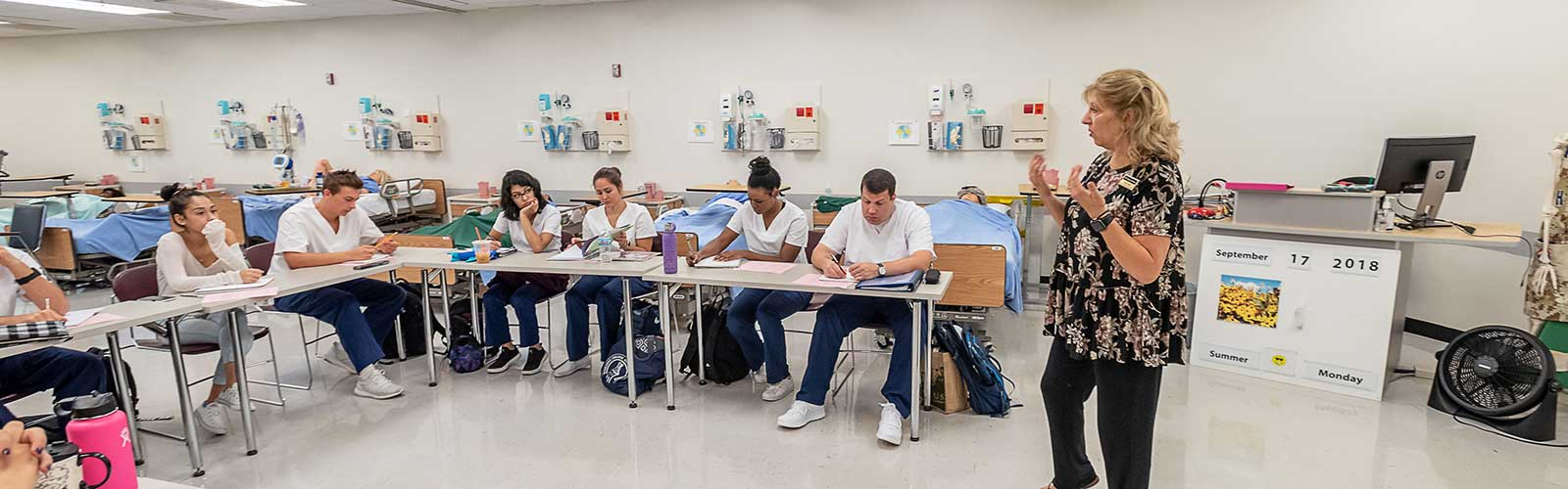 Students in nursing lab classroom