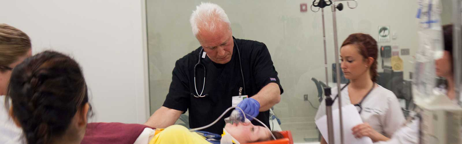 Students learn how to take care of a patient during simulation