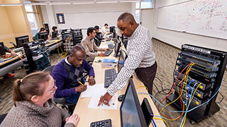 professor teaching students about cybersecurity