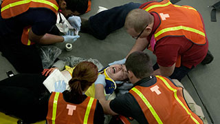 ems students in a simulation