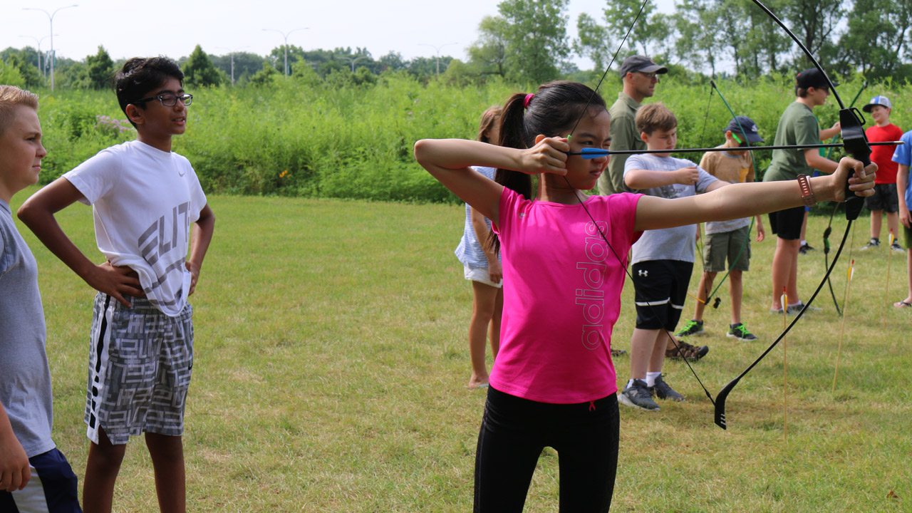 Youth students practicing archery