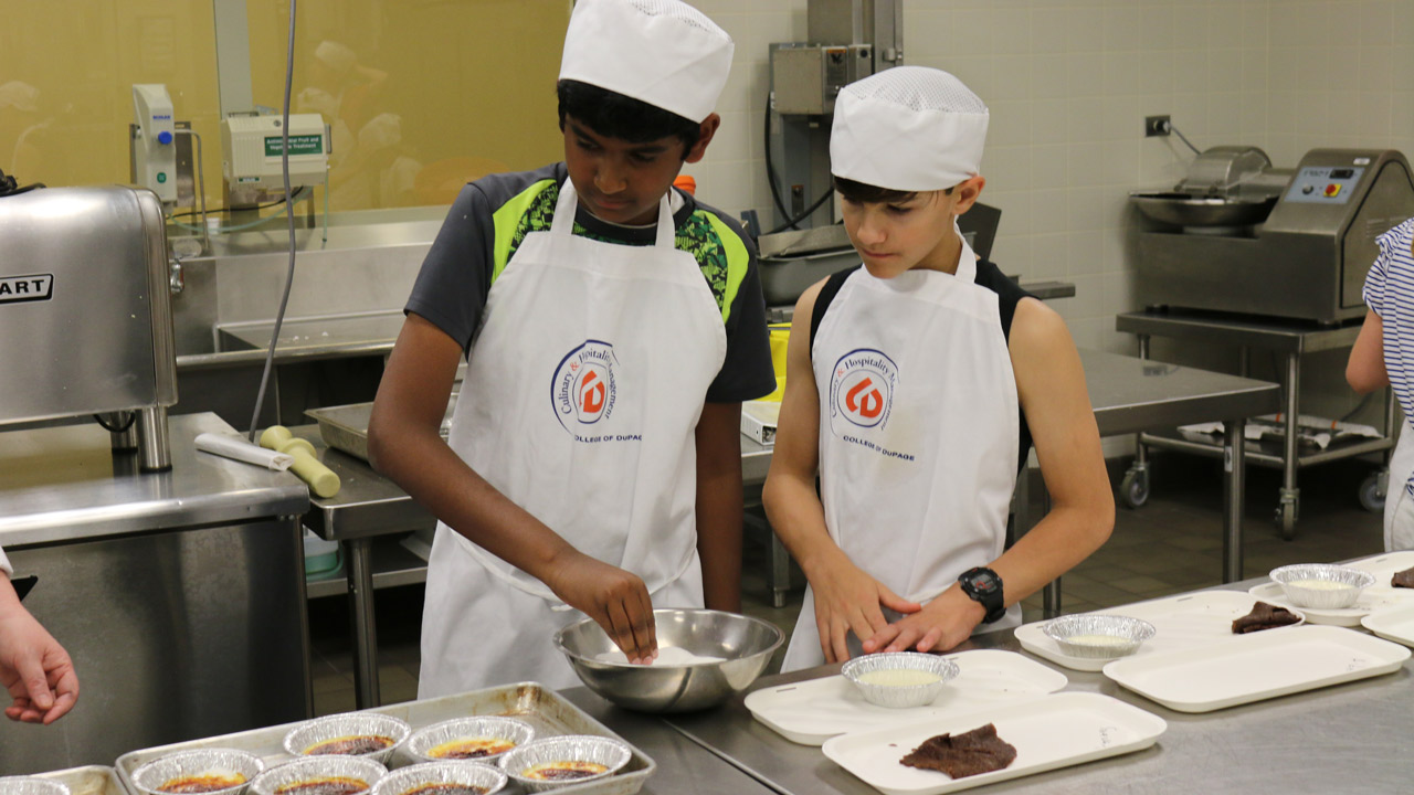 Young students in kitchen