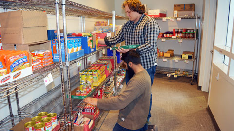 Students stocking Fuel Pantry shelves