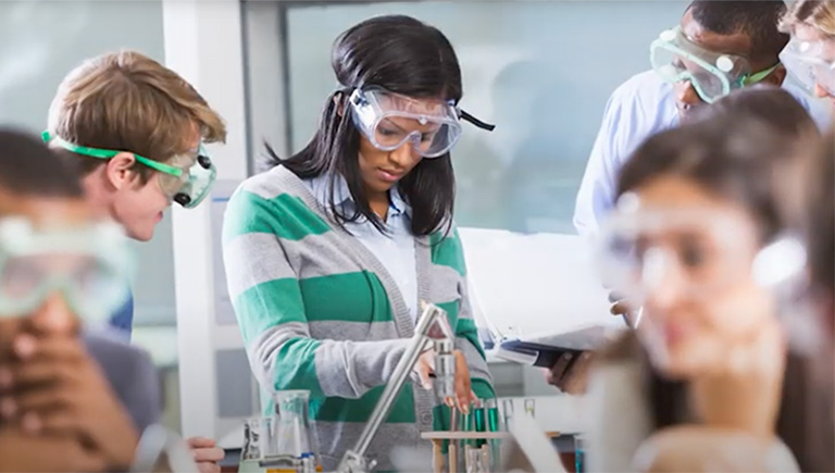 Photo of high school girl working in a chemistry lab