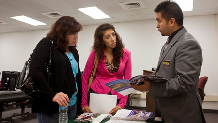 Student and parent talking to an advisor